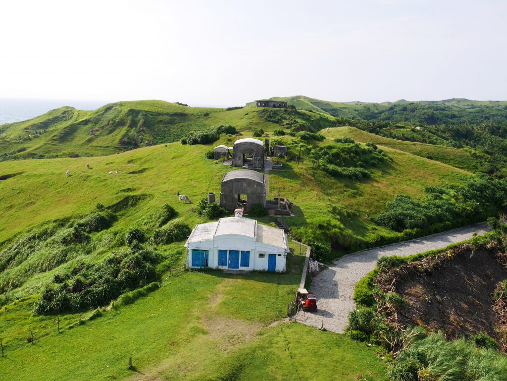 View of Bunker's Café from the Basco Lighthouse and that is Jared's tricycle.